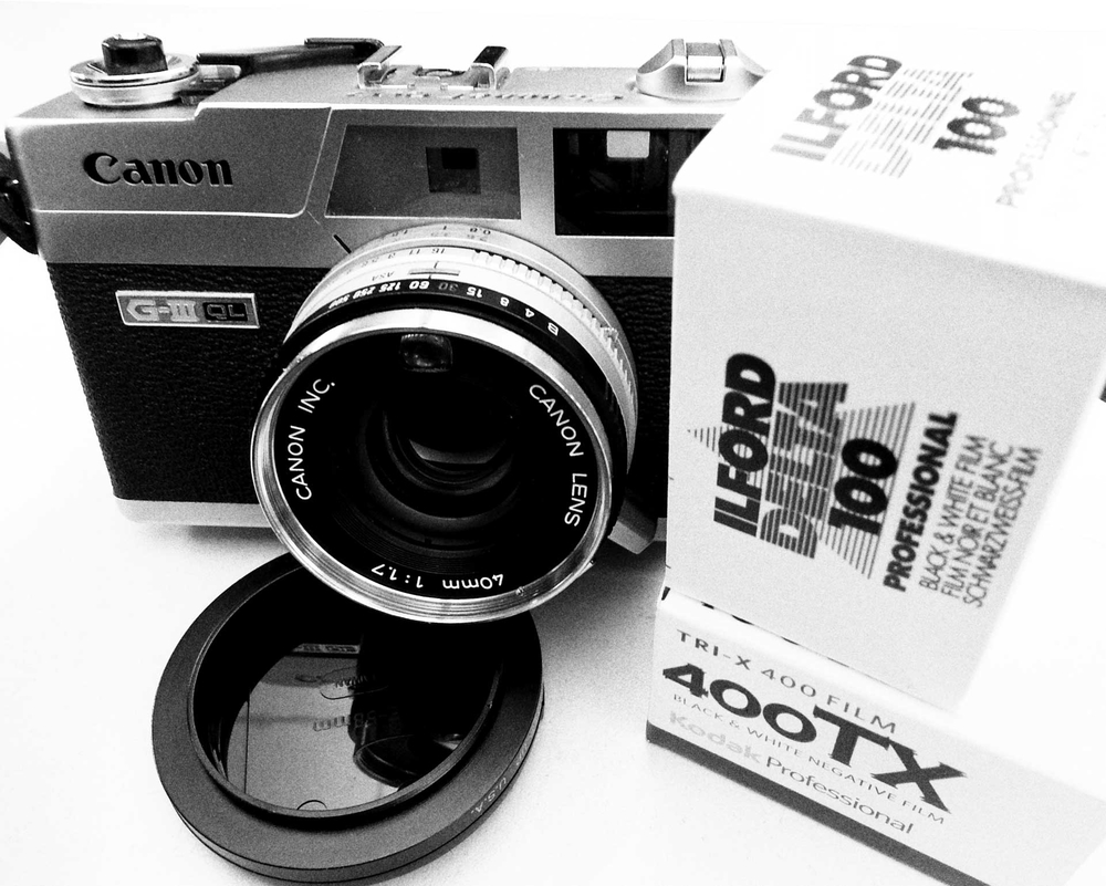 The Canonet QL-17 GIII, a 1970's-era Canon rangefinder, with Kodak Tri-X 400 and Ilford Delta 100 boxes of film