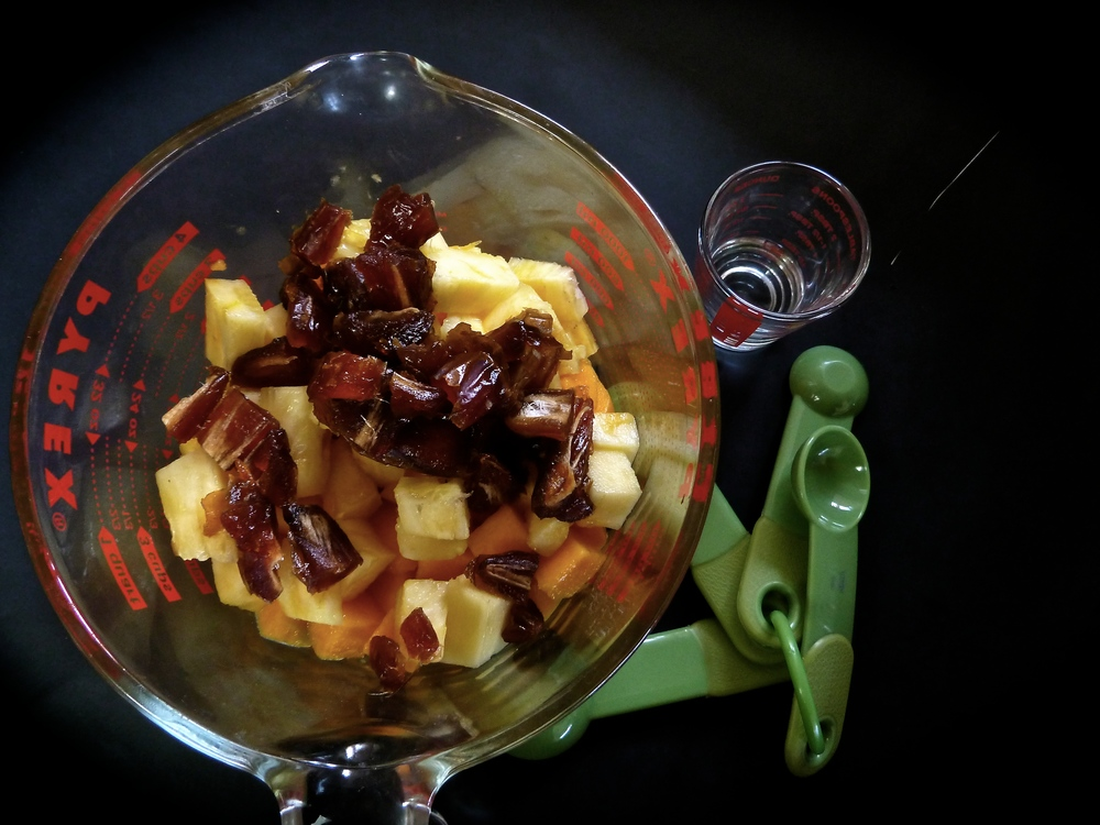 A quart-size measuring cup holds the mango, pineapple and dates. If fresh mango isn't available, look for frozen cubes or you can substitute it with more pineapple.