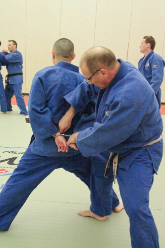 Preparing for handcuffing with twisting wristlock from standing