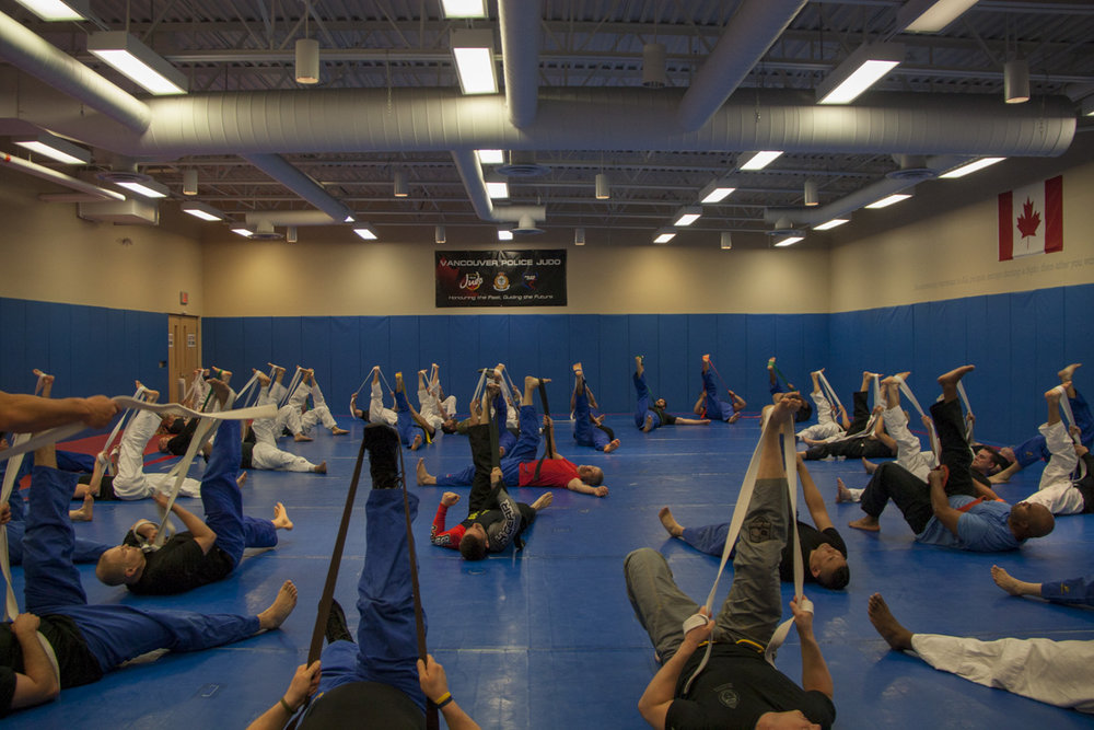 Wayne Unger leading stretching VPD Police Judo Clinic 2018lice-judo-clinic-may-2018--142.jpg