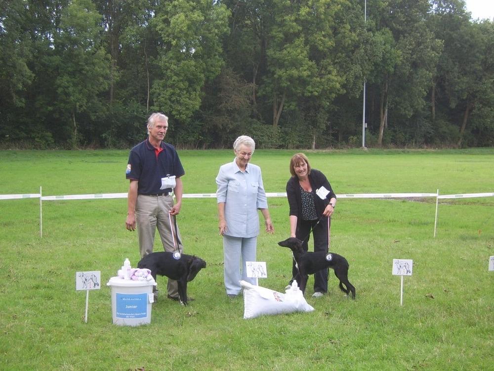 Proud breeder Joachim with best puppy dog and best puppy bitch