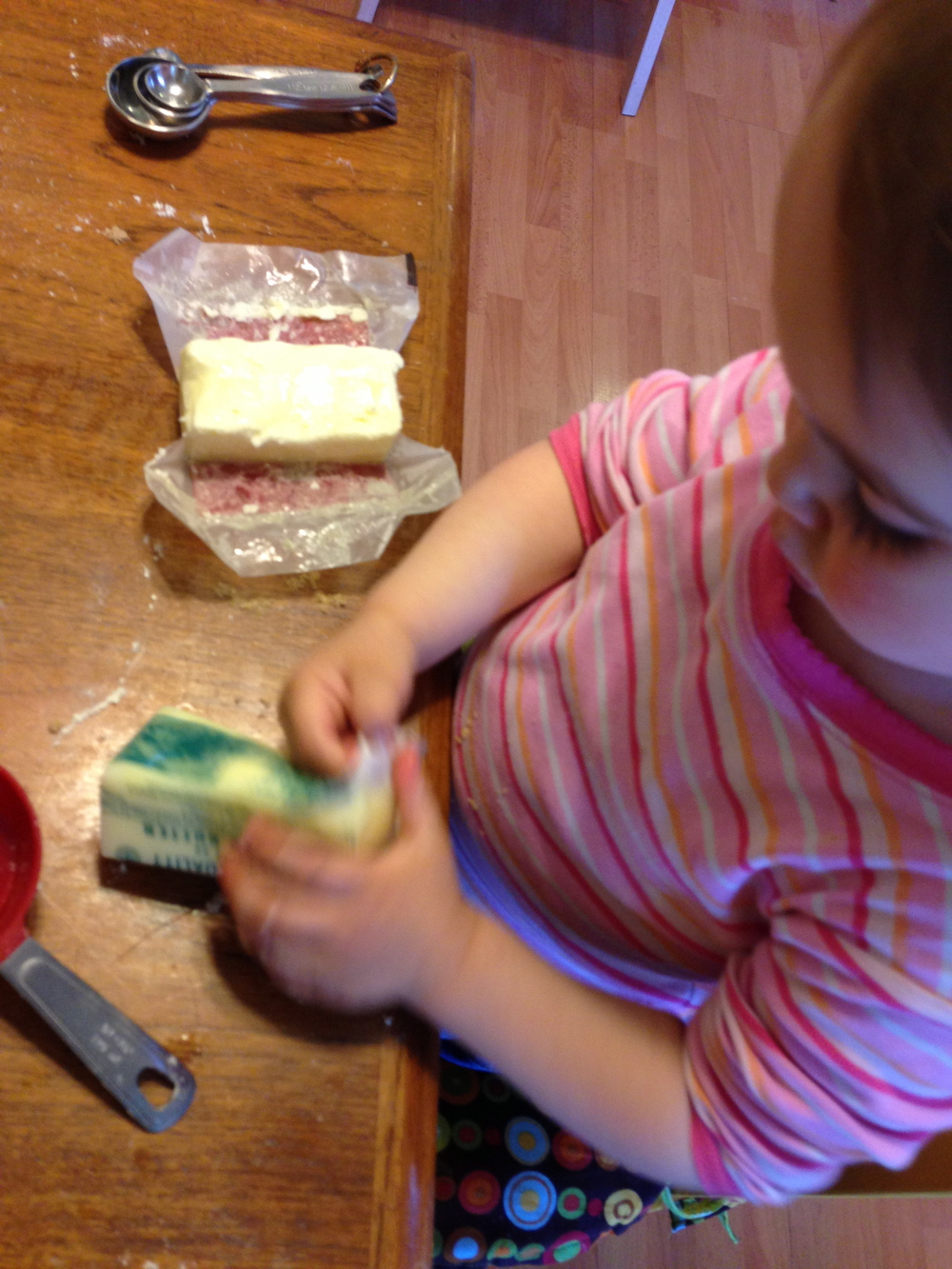 Unwrapping the butter stick gives my daughter such joy. I think she feels it is a grown-up task, and it clearly indicates I am up for a mess.