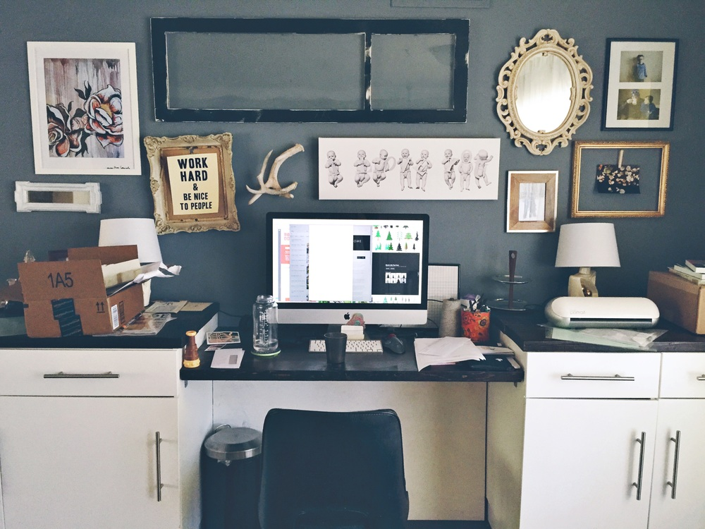 """My real-life """"messy desk"""". Yes, the crooked frame is killing me. And notice that Child #2 has yet to make an appearance on the wall. There are prints of her- they just haven't been hung yet. :)"""