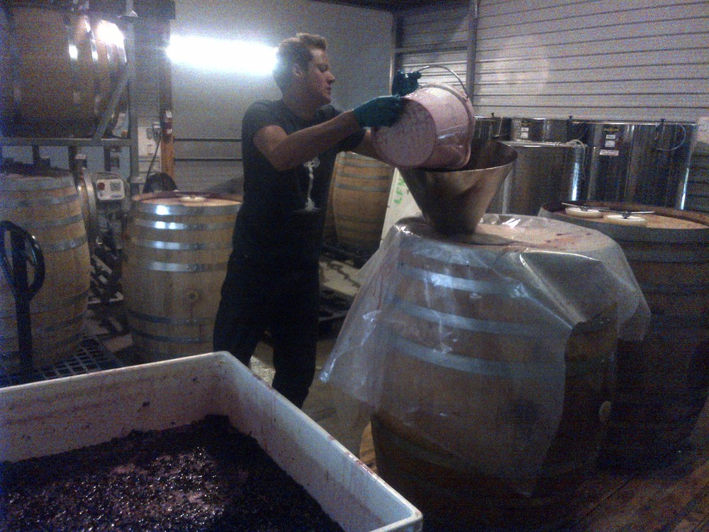 Kalen, David's son loading barrels.