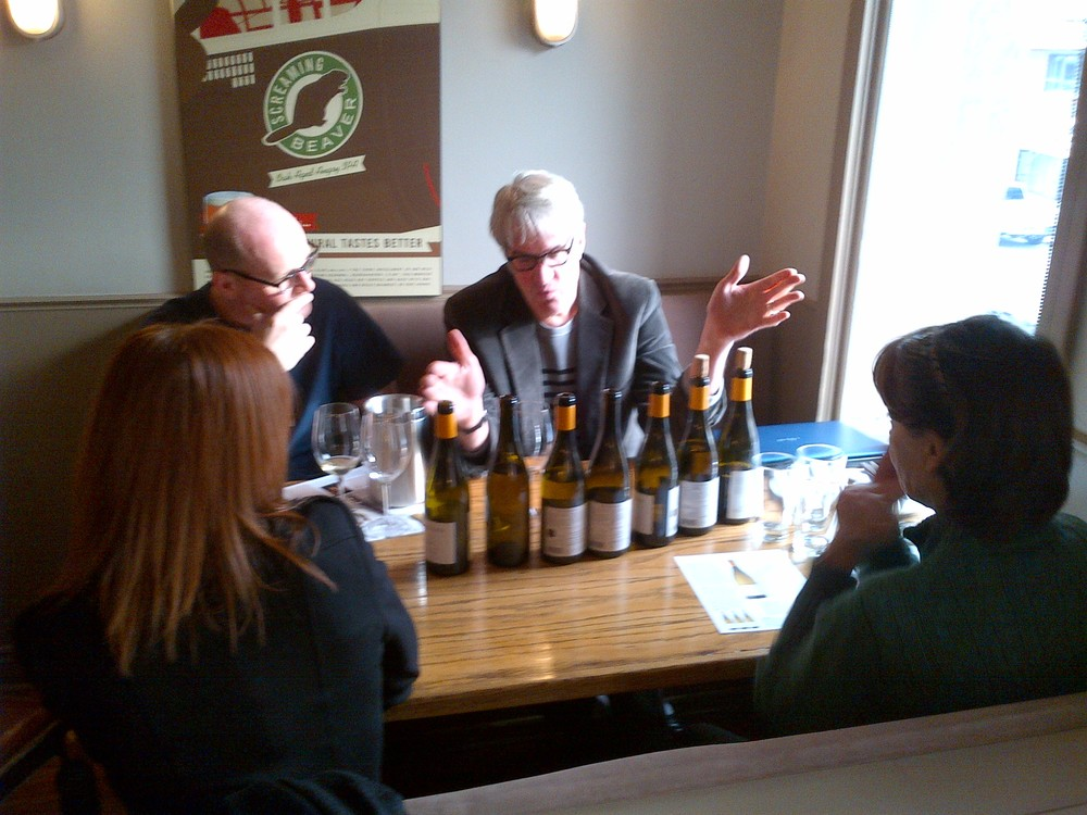 Thomas explaining to us barrel selection and blending, using bottles and corks as visual aids.