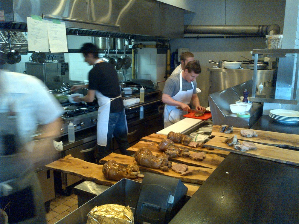 Steve Wall and his team at Supply and Demand plating (or wooding?) the pork on long wood planks for sharing plates.