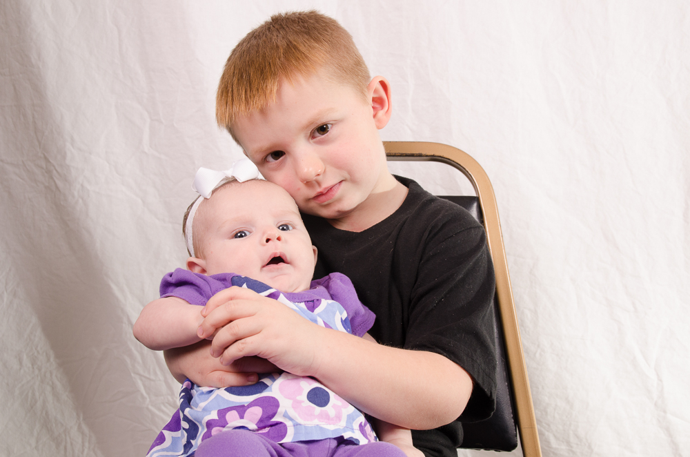 Here's the boy on his 5th birthday holding his little sister!