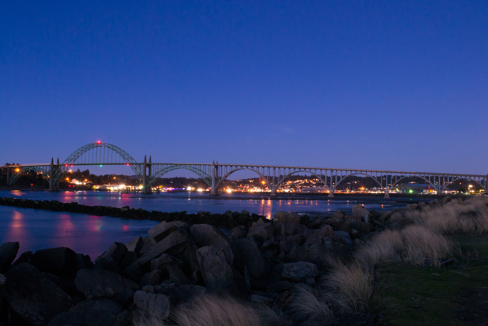 Yaquina Bay Bridge as seen during the blue hour from the south jetty.