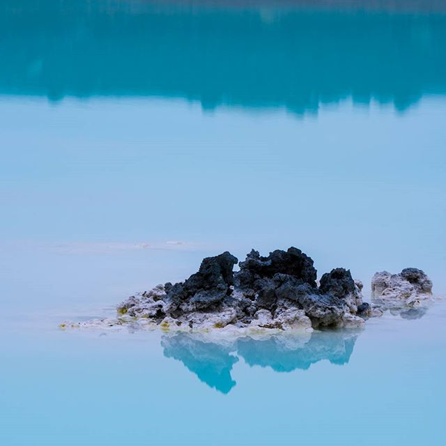 A cloudy but calm morning at the famous blue lagoon in Iceland. Without big epic skies, we looked for the smaller details as we walked along.