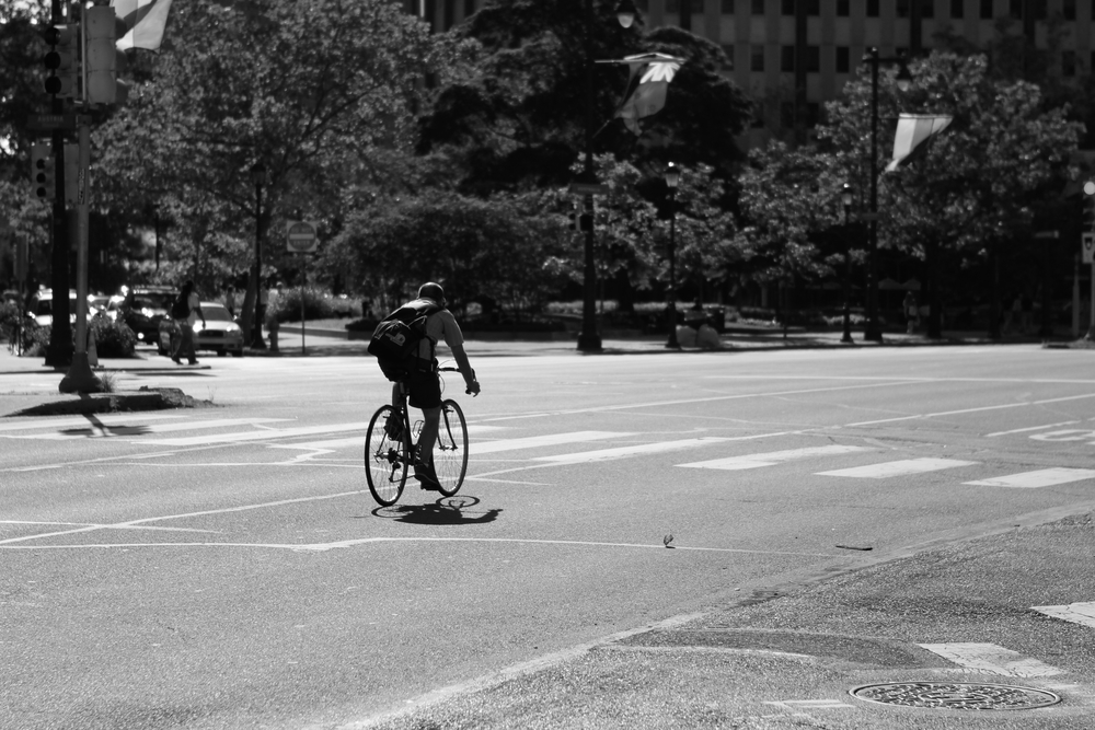 a biker rides down Ben Franklin Parkway in Philadelphia, PA