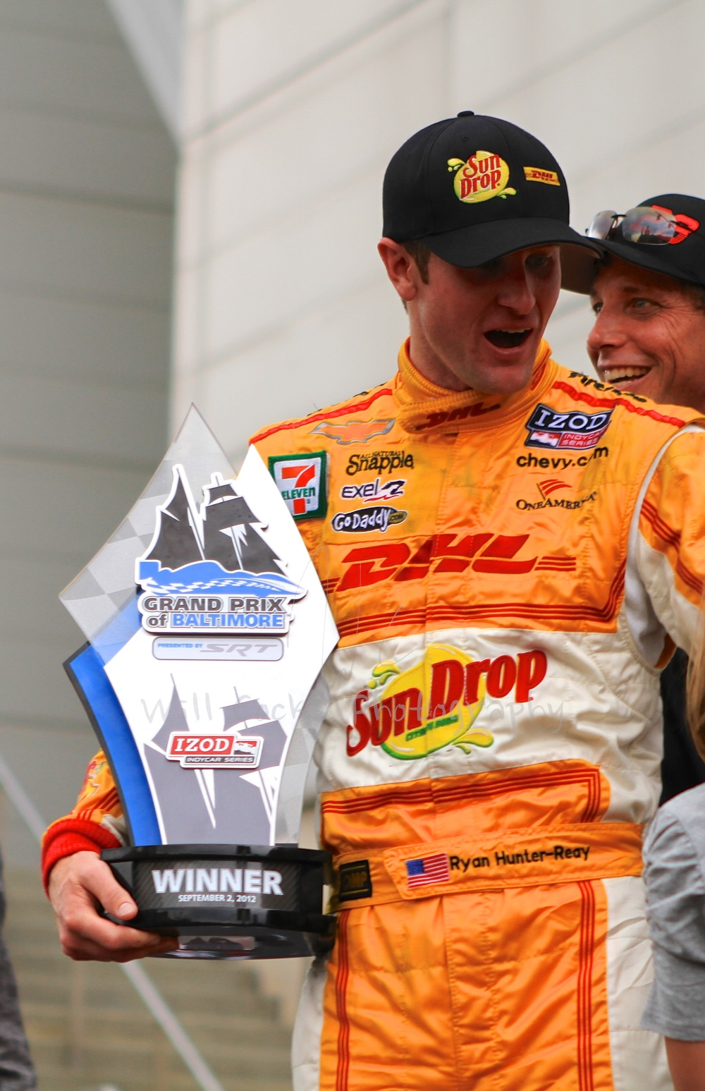 Ryan Hunter-Reay on stage with the Winner Trophy at the Grand Prix of Baltimore