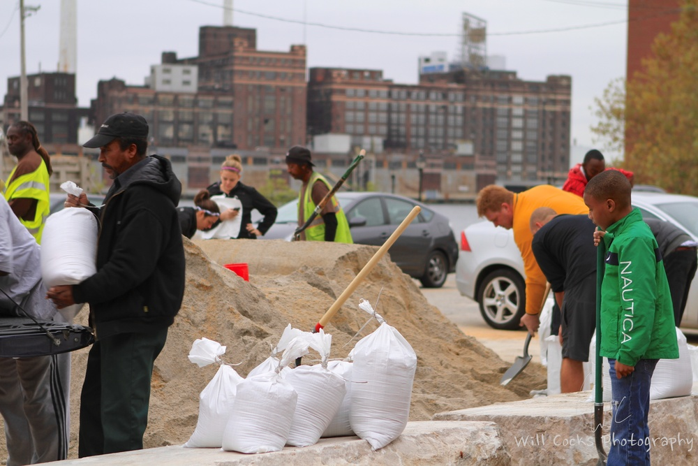 Baltimore residents prepare sand bags in Fells Point