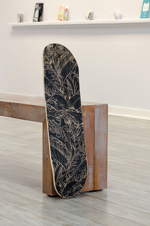 Here is an example of what the finished boards look like by Lindsay Nohl. The decal goes all the way to the edges and is sealed with a varnish -- and is totally skate-able!