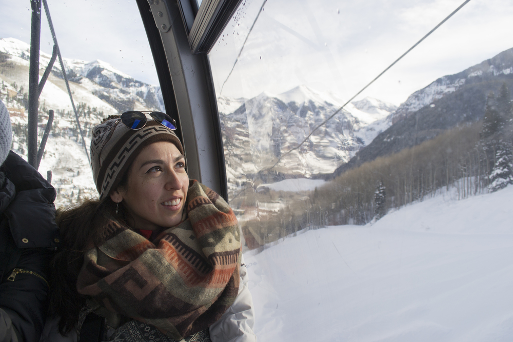 Light Grey Founder, Lindsay Nohl glaces out the gondala window as she sees mountains for the first time!