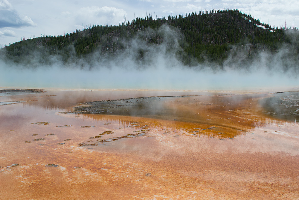 Artists hike near the Grand Prismatic Spring in Yellowstone National Park.