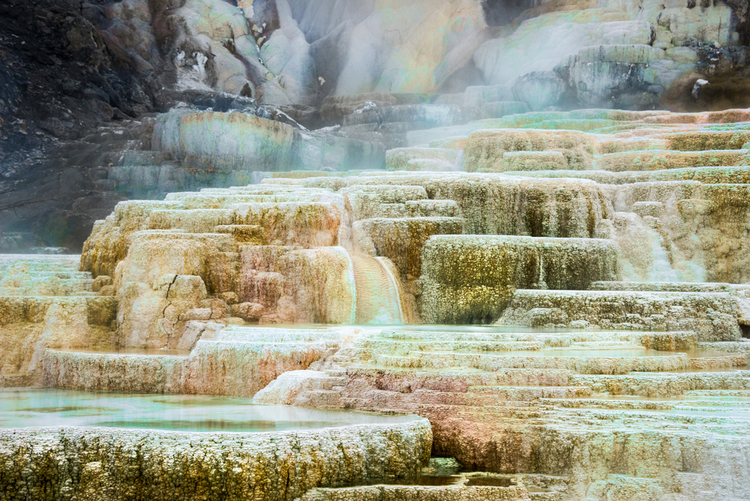 """Mammoth Hot Springs"" - waters cascade over a huge travertine formation"