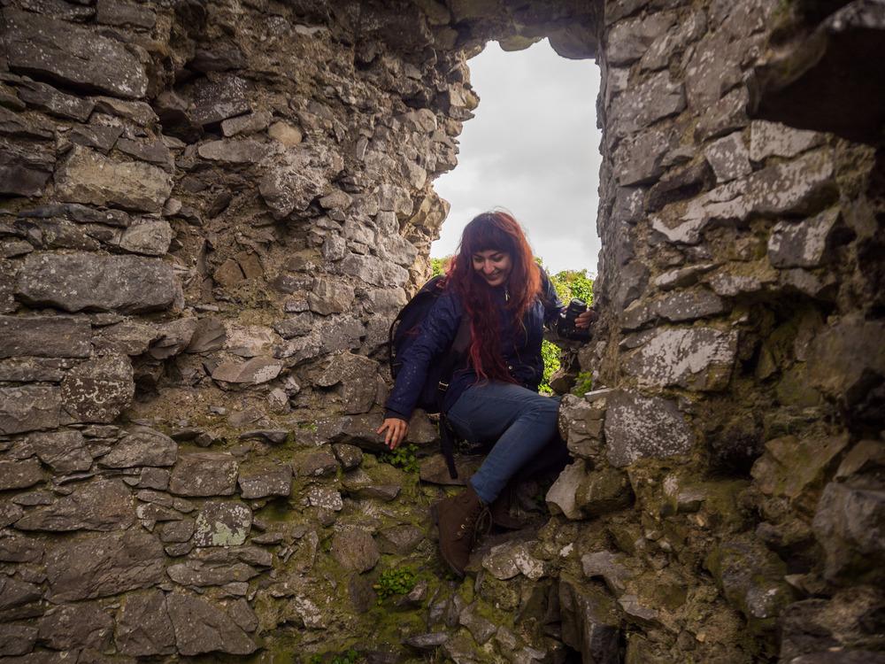 Artist, Niky Motekallum, exploring an abandoned castle