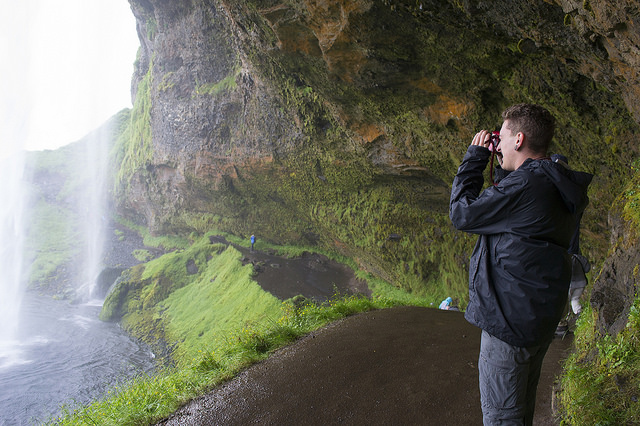 Jared Tuttle, from Team Mist, explores underneath one of Iceland's most recognizable waterfalls.