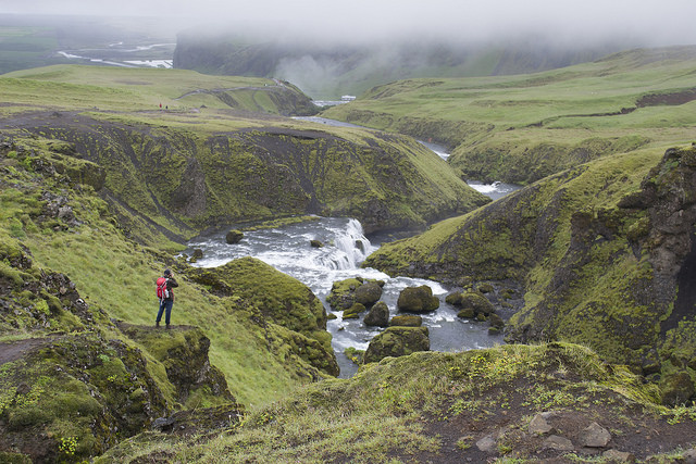 Chris Hajny photographs the waterfall trail above Skógafoss.