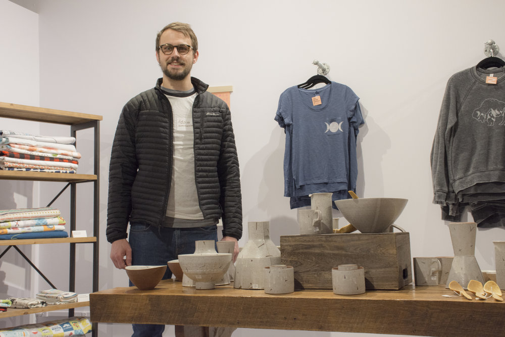 Adam Gruetzmacher with his handmade ceramic works