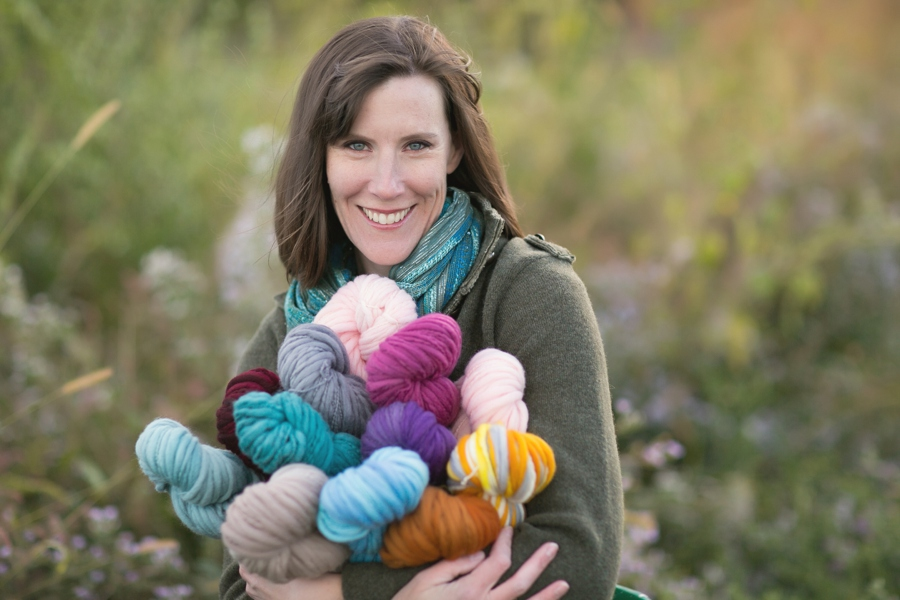 Jackie, of Luna Grey Fiber Arts, arms full of her hand dyed treasures.
