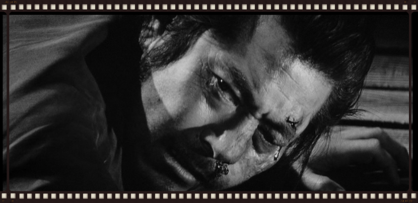 Toshiro Mifune from Kurosawa's Yojimbo beaten up.   How I feel after a conference.