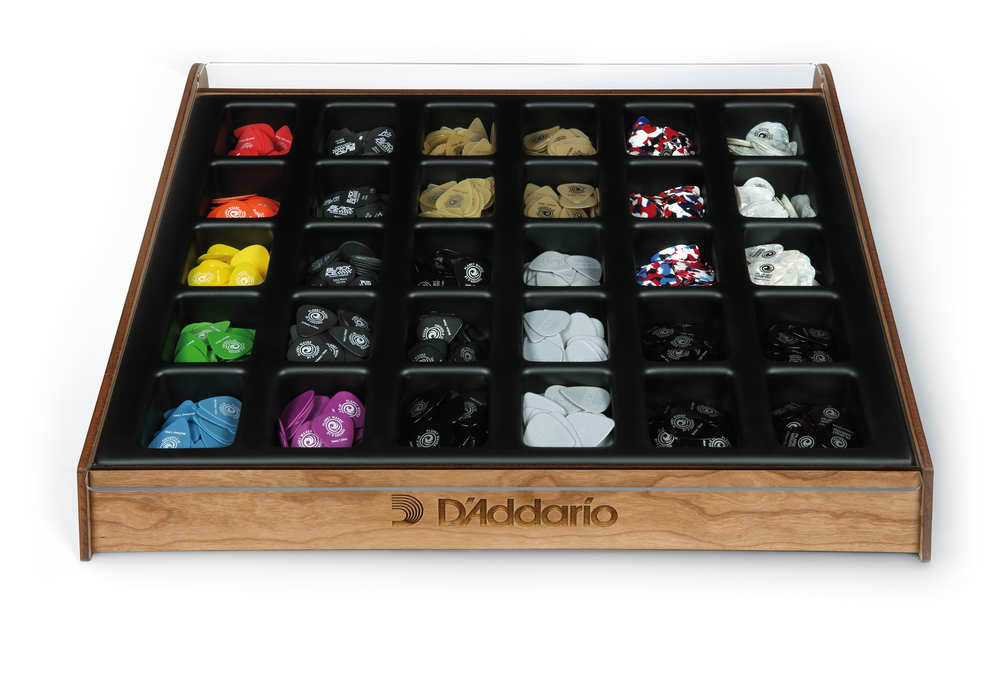 Large Countertop Display  features a beautiful wood finish with 30 compartments for loose guitar picks. Each compartment can hold 50-75 picks. The display is available on its own or as a kit with a standard pick assortment.
