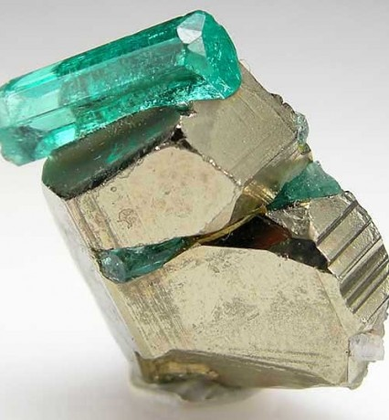 Emerald with pyrite.  Yummy combo, you might see a piece with this soon!