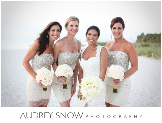 Bridesmaids bouquets of white roses  - a classic look