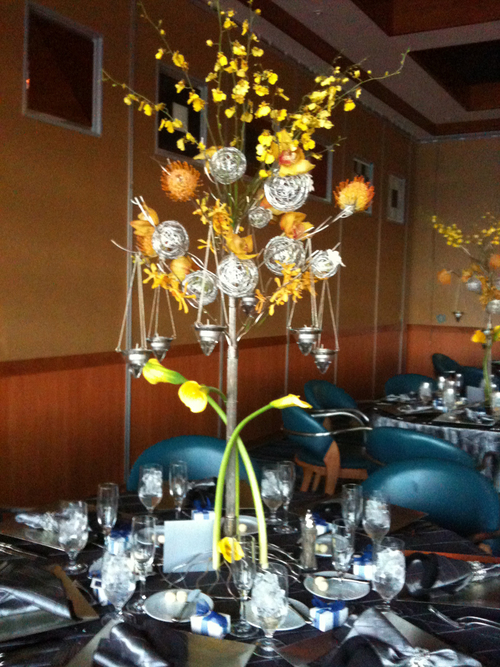 Amazing yellow piece with hanging candles to add lots of drama to this tablescape.
