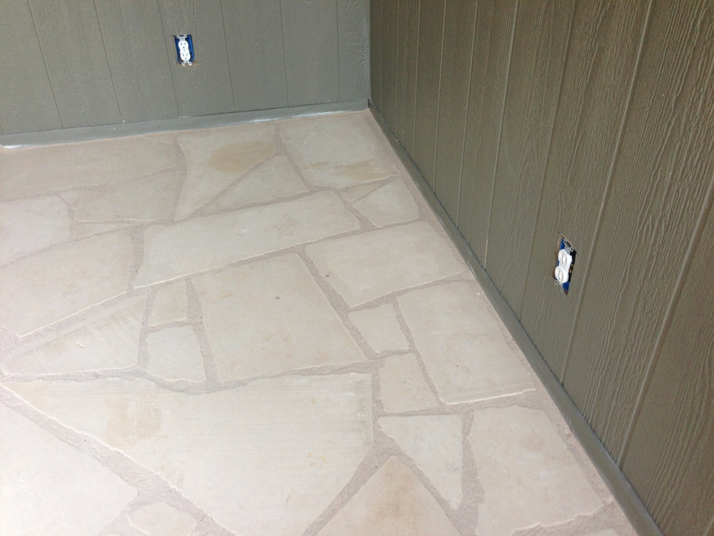 The concrete ended up being too uneven and stained to use, so we had these limestone floors installed. They're amazing!