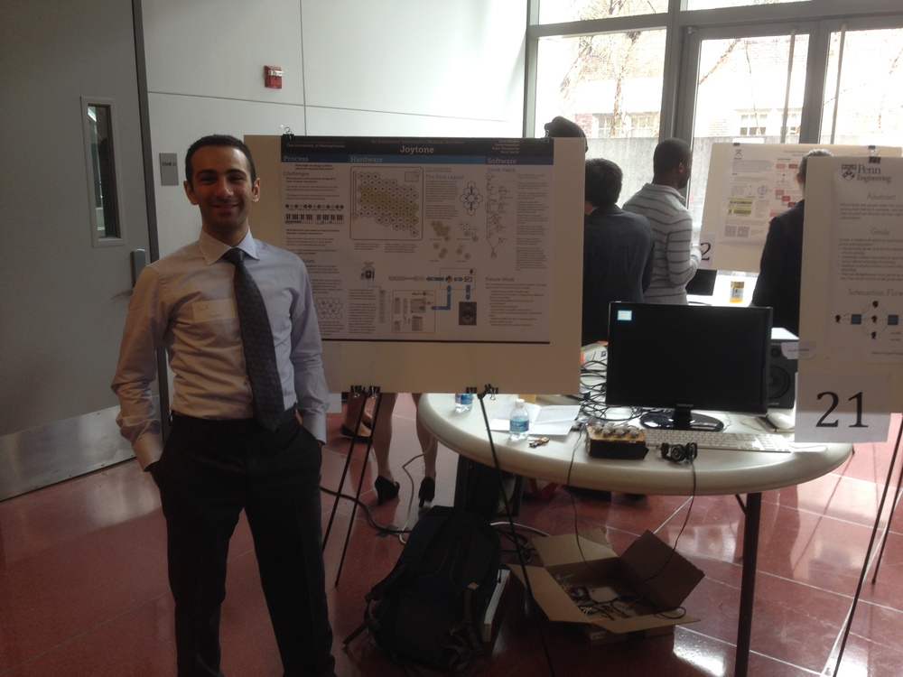 My lab partner, David Glanzman, in front of our poster and demo unit