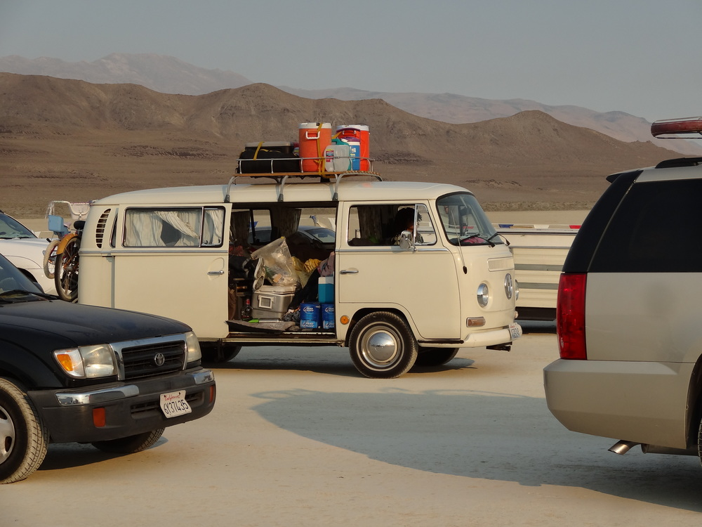 A pristine Volkswagen packed full with a weeks worth of supllies, as well as one sleeping passenger, waits in line to enter Black Rock City. The entry process is tedious, but highly organized. Burners are accustomed to waiting hours in line, which gives them a chance to start meeting new people from all over the world.