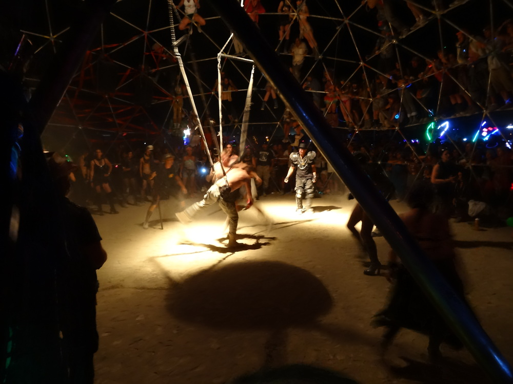 The Thunderdome offers the opportunity for burners to fight with foam swords and bungee cord harnesses. Heavy metal music and leather costumes abound at this camp, which has been returning several years running. The experience is surreal, and most fights end in laughter.