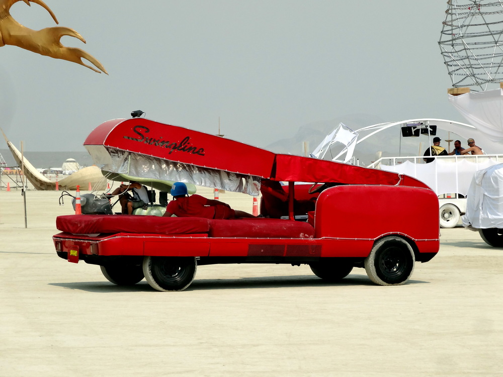 A red Swingline stapler, likely an homage to Office Space. One of the smaller, yet effective, art cars.
