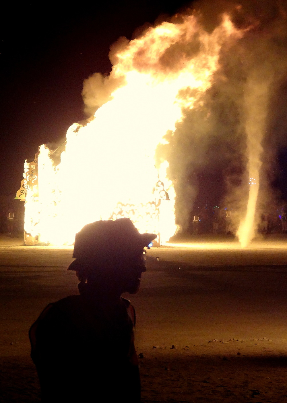Part of the CORE burn on Thursday night. There are four groups of five of these smaller sculptures, which are all burned at once. The wind patterns on the playa create dust devils naturally.