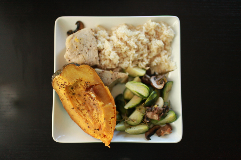Baked Acorn Squash, Rosemary Brussels Sprouts and Crimini Mushrooms, and Lean-Cut Pork Chop with a Side of Brown Rice