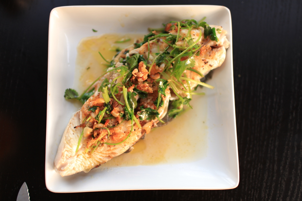 4. Another light and incredible recipe from Alice Waters'  The Art of Simple Food : Pan-Fried Halibut, Garlic, and Cilantro (Hint: first fry the fish, remove from pan, and fry the leftover bits and oil with minced garlic; then pour over fish to serve immediately)