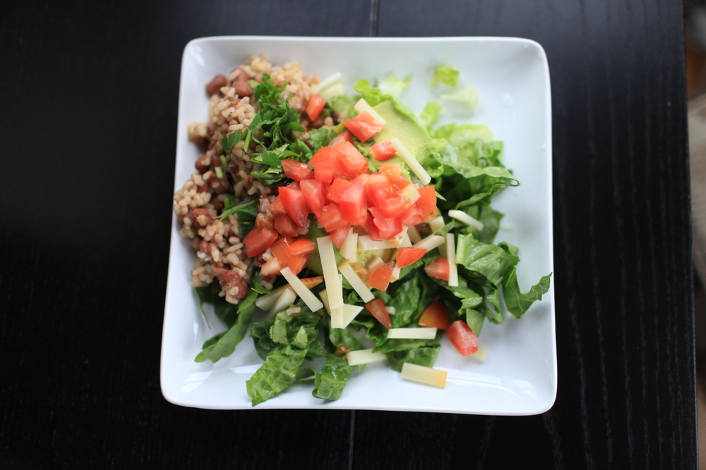 9. Cal-Mex Toss Up: Chopped Romaine, Diced Plum Tomatoes, Scooped Haas Avocado,Muenster Cheese, Cilantro,and Garlic-Fried Leftover Short-Grain Brown Rice and Canned Pinto Beans. There is just a special satiation that comes from consuming an admixture of cooked and raw ingredients.