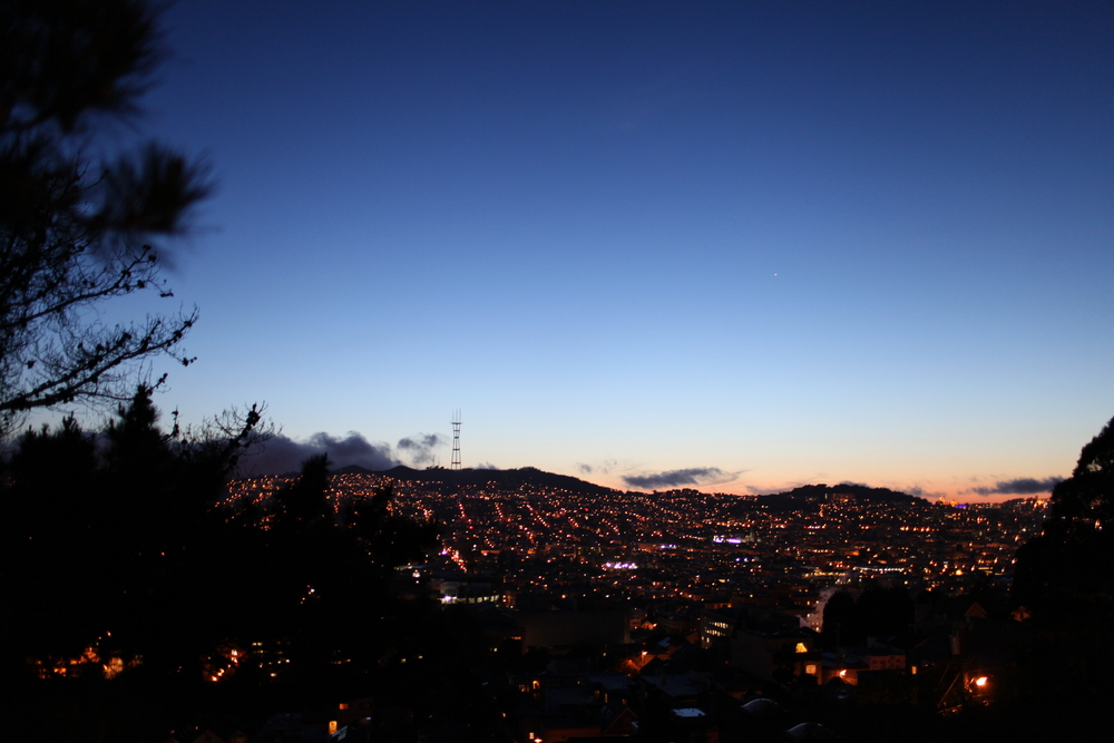 the view of the mission, noe valley, twin peaks and mount sutro from our living room at night