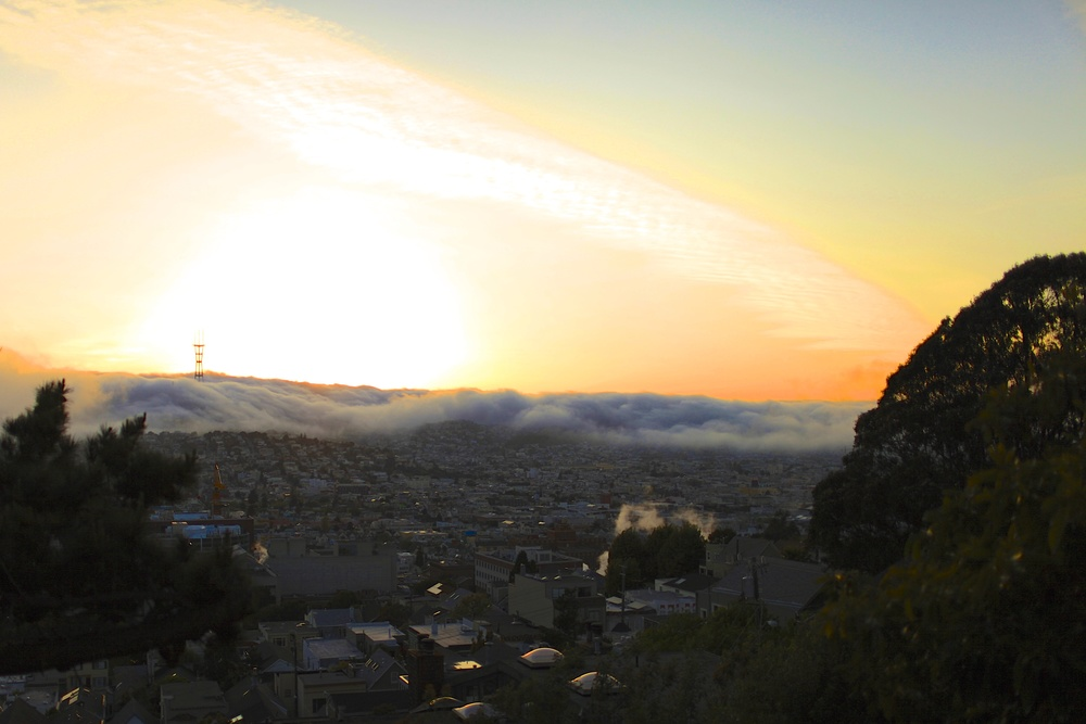 a new sunset everyday. this one featured  Karl the Fog  flowing into Noe Valley.