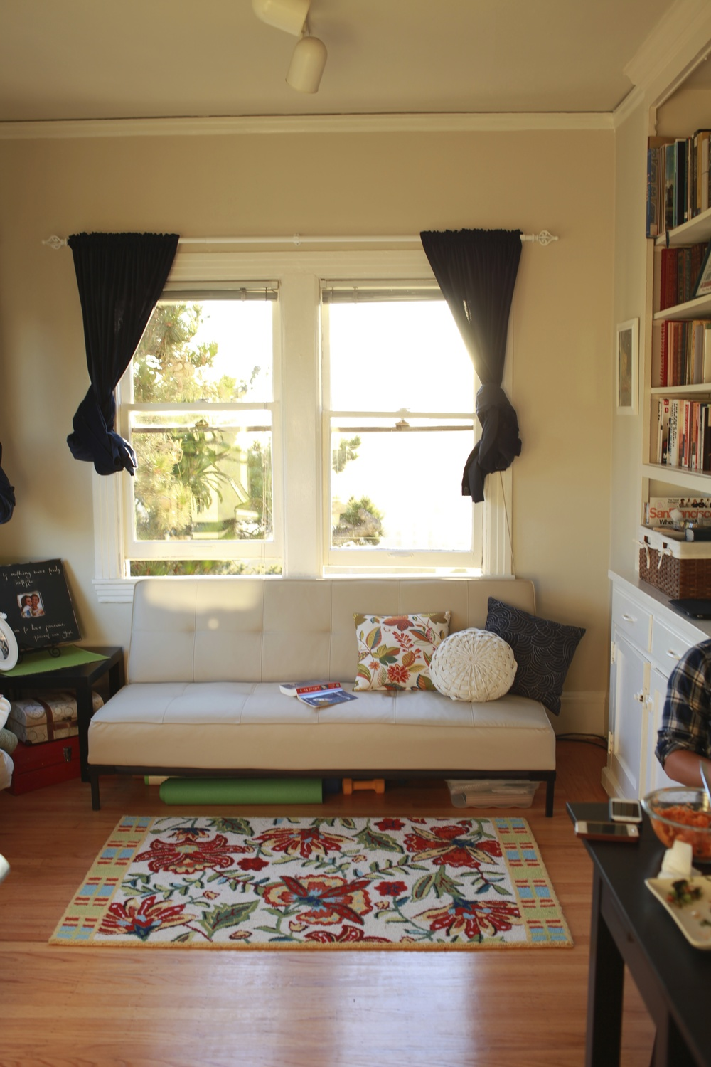 the sun bathed the SW-facing apartment in warm afternoon light, rendering it a sanctuary for the senses. living room pictured here.