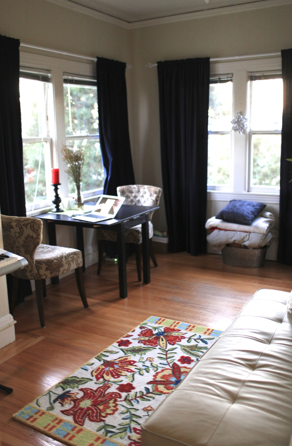 full view of the living room, with both south and west windows (with furniture rearranged)