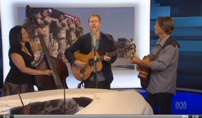 "Playing ""Going Home"" in the ABC Newsroom with Fred Smith. Click to view."