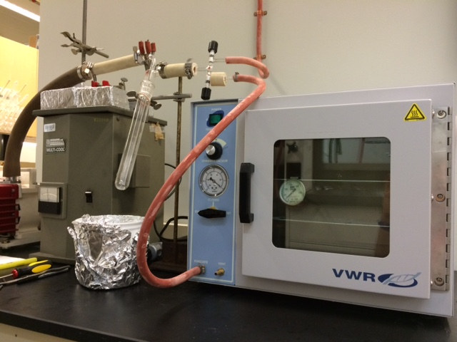 Vacuum oven and solvent trap for synthesis hood