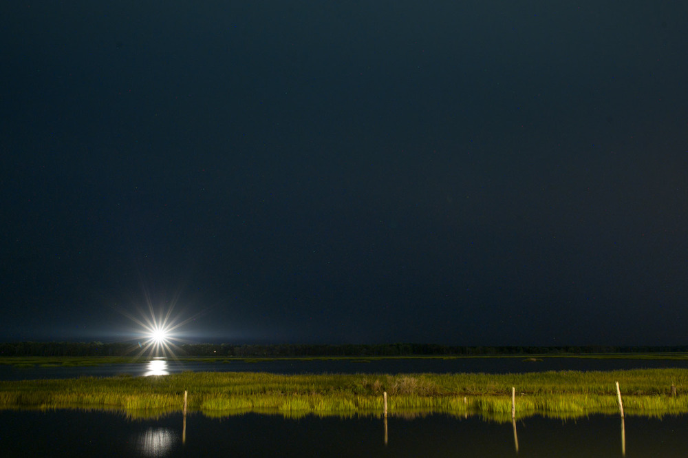 A view at night from the dock looking out towards Chincoteague National Wildlife Refuge.