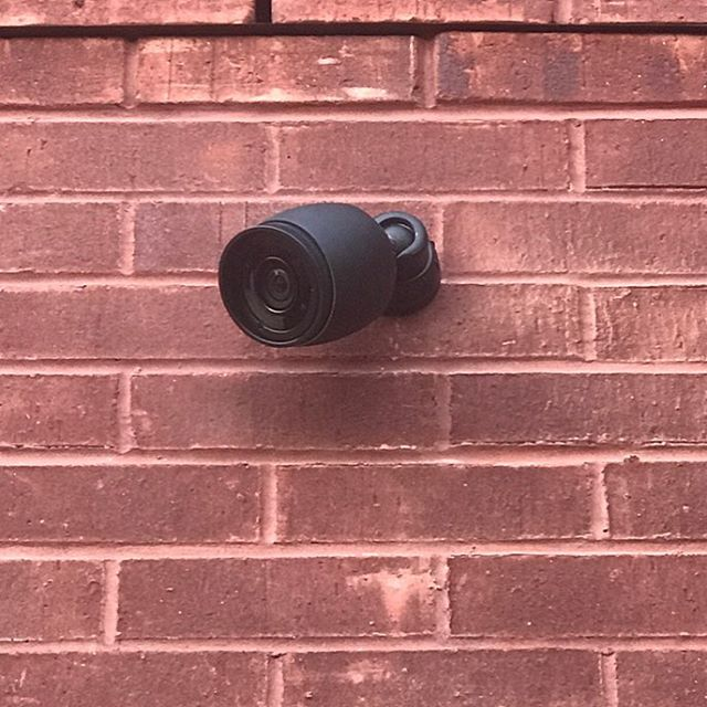 It's such a small detail, but our job is to sweat the details. This previously white surveillance camera has been color matched to the buildings window frames. Protected without being an eye sore. #unifiprotect