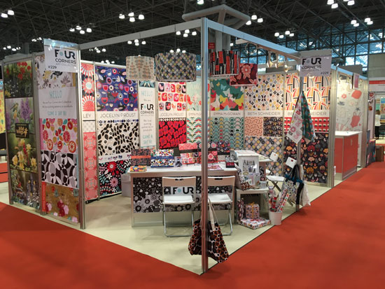 Our final booth. Look closely in the corner, we have 4 lampshades with our designs on them!