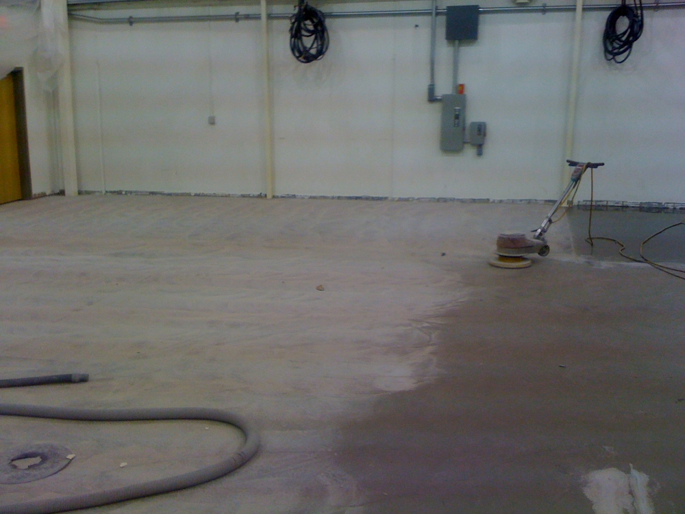 Sand abrading the previous coating
