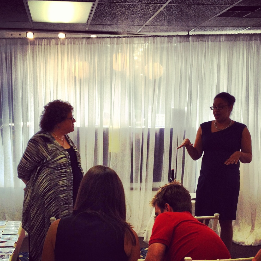 Pictured: Rev. Jill Magerman (left) and Chief Event Planner Randi Martin (right) discussing writing your vows